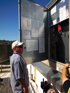 Cam Isaza of Marin Department of Public Works inspects the new unit.